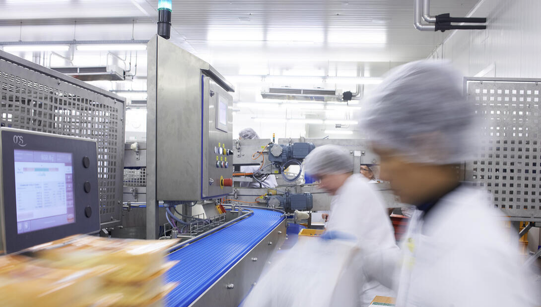 women working in food and beverage processing, fast paced environment
